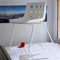 A maquette of the Polyprop chair sits beneath a white Polo chair on top of  Robin Day's drawing table