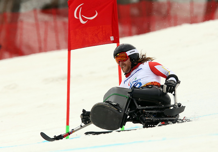 Sochi, Russia,09/03/2014. Canadian Caleb Brousseau competes in the men's Super G, sitting skiing at the 2014 Paralympic Games in Sochi, Russia. Brousseau won bronze in the event.Photo(Scott Grant/Canadian Paralympic Committee)