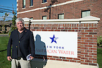 "Merrick, New York, USA. October 23, 2016. MICHAEL F. REID, the Democratic Party candidate for New York State Assembly District 14, poses at company sign outside the New York American Water Headquarter during environmental and civic groups' rally to demand public water and protest New York American Water's (""NYAW"") proposal to raise residents' water bills by 9.90%"