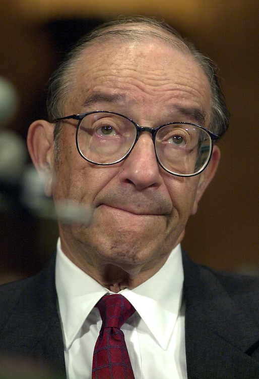 3greenspan062001 -- Alan Greenspan, Chairman of the Federal Reserve,looks up at a Senate Committee hearing to examine the Condition of the United States banking system.
