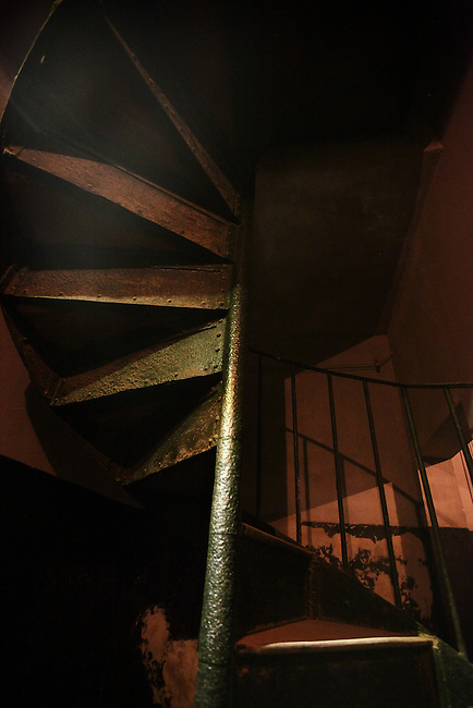 "An iron stairwell is illuminated inside the former Hoa Lo prison in Hanoi, Vietnam. Known as the ""Hanoi Hilton"" to U.S. pilots held there after being shot down during the Vietnam War, most of the structure was demolished after the conflict ended. The museum focuses primarily on the brutal conditions under which Vietnamese political prisoners were held during the French colonial era. Oct. 27, 2012."