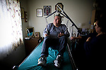 In Home Supportive Services (IHSS) caregiver Teresita Perez de Godoy, right, uses a lift to get quadriplegic Francisco Godoy out of his wheelchair and into bed at his Sacramento, CA home January 22, 2010. Francisco needs around-the-clock care from Teresita, his ex-wife who also lives with him. The state pays Teresita for 283 hours per month, at $10.40/hour. Gov. Schwarzenegger has proposed cutting or eliminating the IHSS program which provides care for 450,000 Californians and jobs for 375,000 caregivers. If the program was eliminated, most would need to be institutionalized, likely at far greater taxpayer expense. CREDIT: Max Whittaker for The Wall Street Journal.CABUDGET