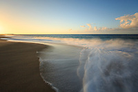 A long exposure of the surf and sand at sunset at Lumaha'i Beach, Kaua'i.