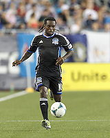San Jose Earthquakes midfielder Walter Martinez (10) brings the ball forward.  In a Major League Soccer (MLS) match, the New England Revolution (white) defeated San Jose Earthquakes (black), 2-0, at Gillette Stadium on July 6, 2013.