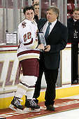 Joe Bertagna presents Mary Restuccia (BC - 22) with the MVP award. - The Boston College Eagles defeated the Harvard University Crimson 3-1 to win the 2011 Beanpot championship on Tuesday, February 15, 2011, at Conte Forum in Chestnut Hill, Massachusetts.
