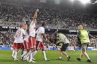 Mike Petke (12) of the New York Red Bulls celebrates scoring during the first half of a friendly between Sanots FC and the New York Red Bulls at Red Bull Arena in Harrison, NJ, on March 20, 2010.