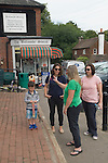 Balcombe West Sussex UK. Local residents chat iin the village outside the Balcombe Stores.