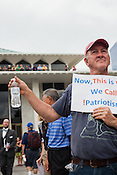 Tom O'Dwyer of Chapel Hill hands out water to attendees during Moral Monday protest at the North Carolina State Legislature in Raleigh.