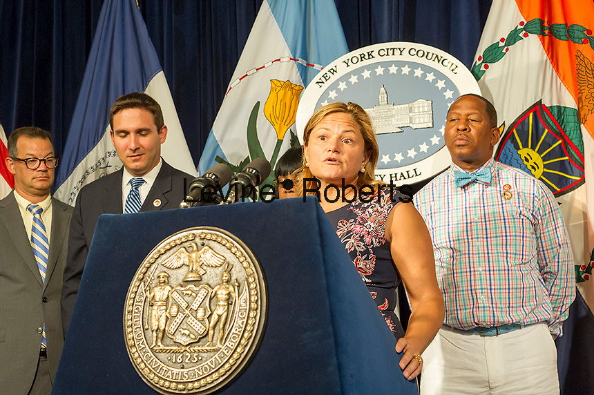 New York City Council Speaker Melissa Mark-Viverto and members of the New York City Council hold a news conference in the Red Room of NY City Hall about pending legislation including consumer protection for women, immigrants, and seniors, on Tuesday, August 16, 2016. (© Frances M. Roberts)