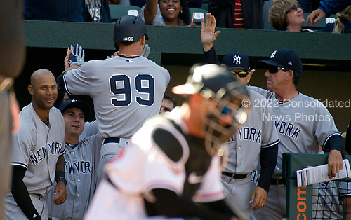 New York Yankees right fielder Aaron Judge (99) celebrates with his teamates as he returns to the dugout after connecting for a game-tying home run in the eighth inning against the Baltimore Orioles at Oriole Park at Camden Yards in Baltimore, MD on Sunday, April 9, 2017.  The Yankees won the game 7 - 3. <br /> Credit: Ron Sachs / CNP<br /> (RESTRICTION: NO New York or New Jersey Newspapers or newspapers within a 75 mile radius of New York City)