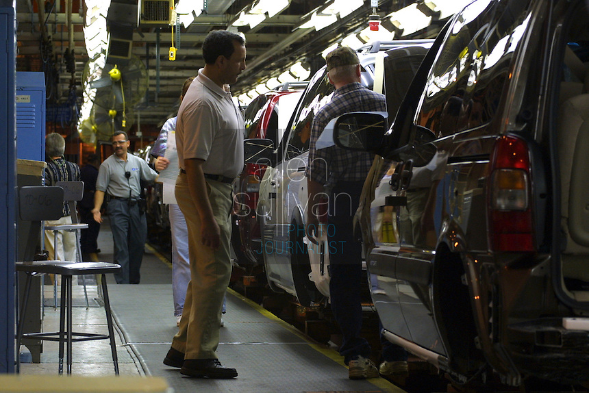 Workers assemble Montana vans at the General Motors Doraville Assembly Plant in 2003. The plant is one of several being closed by GM.