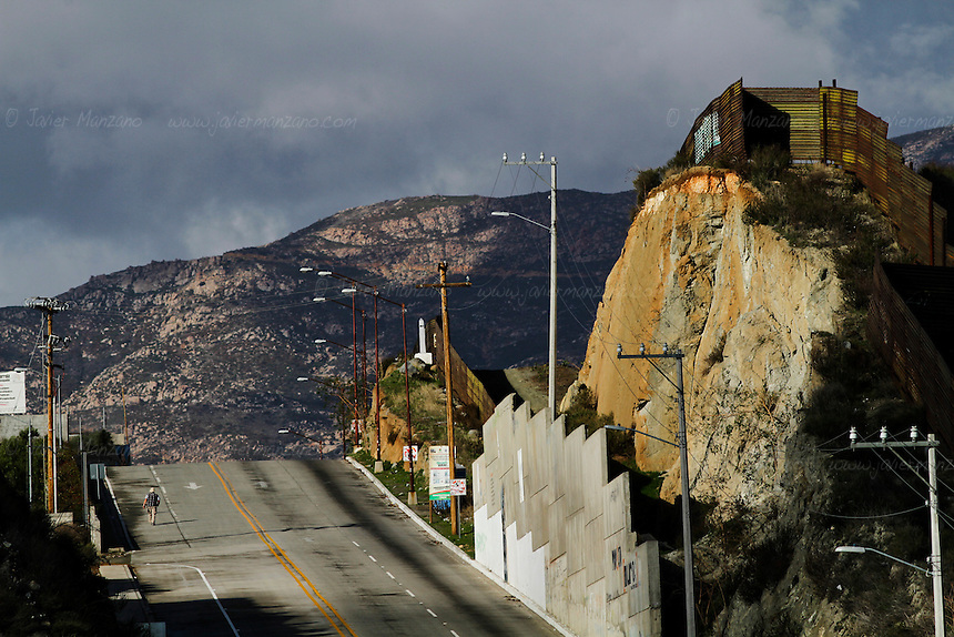 The border fence that separates California from the town ofTecate, Baja California, Mexico - February 8, 2013.  (Javier Manzano / For The Washington Post).