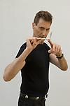 Uri Geller at home Berkshire England 2008. Bending spoon 5th image taken at 16. 37. 32 pm.