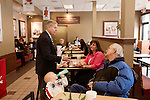 March 26, 2013. Lexington, South Carolina. On his way to meet with a local mayor, Sen. Lindsey Graham stopped by a Chick-fil-A to get some lunch and talk to customers, including (left to right) Colton Thomas Clegg, Betty Oxner and Rick Clegg.. Sen. Lindsey Graham, R- South Carolina, is up for reelection in 2014. He spent some time talking to his base back home about issues such as immigration reform as he readies himself for his campaign run..