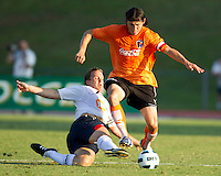 Matthew Taylor of the Bolton Wanderers slides to efend aginst the Charlotte Eagles Josh Rife.  The Charlotte Eagles currently in 3rd place in the USL second division played a friendly against the Bolton Wanderers from the English Premier League on 7/14/10 losing 3-0.