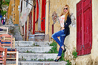 A beautiful woman in the streets of Plaka in Athens, Greece