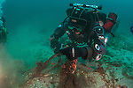 Global Underwater Explorers (GUE) diver works to remove abandoned ghost net that continues to fish and kill indiscriminately underwater.