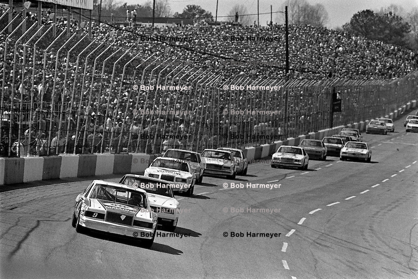HAMPTON, GA - MARCH 27: Bill Elliott, driving the Harry Melling Ford, leads a group of cars into Turn 1 during the Coca-Cola 500 NASCAR Winston Cup race at Atlanta Motor Speedway near Hampton, Georgia, on March 27, 1983.