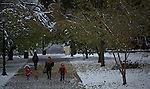 United States, New Jersey. Children walk through a park covered with  snow after the pass of the nor'easter winter storm in Jersey City, New Jersey. 08/11/2012. Photo by Eduardo Munoz Alvarez / VIEWpress.