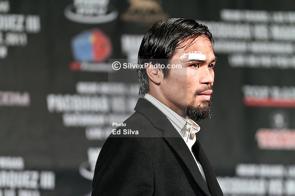 IMAGE: http://cdn.c.photoshelter.com/img-get/I0000yg_iZAUvhJo/s/600/600/Manny-Pacquiao-at-Press-Conference-20111112-7193.jpg