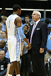 09 November 2012: UNC head coach Roy Williams (right) talks with Dexter Strickland (1). The University of North Carolina Tar Heels played the Gardner-Webb University Runnin' Bulldogs at Dean E. Smith Center in Chapel Hill, North Carolina in an NCAA Division I Men's college basketball game. UNC won the game 76-59.