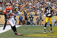 PITTSBURGH, PA - DECEMBER 04:  A.J. Green #18 of the Cincinnati Bengals catches a touchdown pass in the first half in front of Ike Taylor #24 of the Pittsburgh Steelers during the game on December 4, 2011 at Heinz Field in Pittsburgh, Pennsylvania.  (Photo by Jared Wickerham/Getty Images)