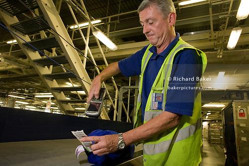 Airport Baggage Handling Scan : England london british airways baggage handler at
