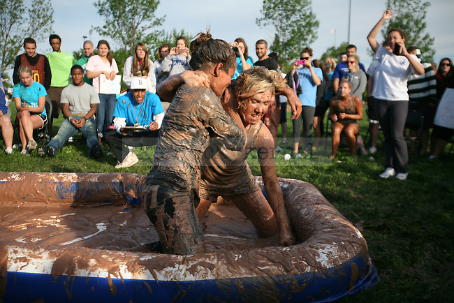 Two girls wrestle during pudding wrestling at Alpha Omicron Pi and Iota Phi Theta's philanthropy event at Goodbarn Field in Lexington, Ky., on Thursday, April 5, 2012. Photo by Tessa Lighty | Staff