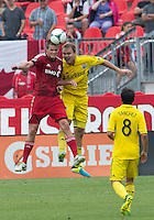 July 20, 2013: Columbus Crew defender Chad Marshall #14 and Toronto FC forward Justin Braun #17 in action during a game between Toronto FC and the Columbus Crew at BMO Field in Toronto, Ontario Canada.<br /> Toronto FC won 2-1.
