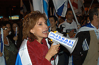 "Roma 3 Novembre 2005.Fiaccolata, davanti all'ambasciata iraniana di Roma, per diritto d'Israele all'esistenza, alla sicurezza e alla pace, contro le dichiarazioni antisemite del presidente iraniano Mahmoud Ahmadinejad, organizzata dal quotidiano ""Il Foglio""  diretto da Giuliano Ferrara. Alda d'Eusanio, giornalista  e conduttrice televisiva  italiana.Rome, November 3, 2005.Torchlight procession, in front of the Iranian Embassy in Rome, to the right of Israel to exist, for security and peace, against anti-Semitic statements by Iranian President Mahmoud Ahmadinejad organized by the newspaper ""Il Foglio"" directed by Giuliano Ferrara.Alda d'Eusanio, journalist, TV presenter Italian"