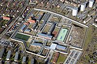 Lauerhof Justivollzugsanstalt in Luebeck: EUROPA, DEUTSCHLAND, SCHLESWIG- HOLSTEIN, LUEBECK, (GERMANY), 26.02.2012: Die Justizvollzugsanstalt Luebeck (auch Lauerhof genannt) befindet sich auf dem Lauerhoefer Felde im Luebecker Stadtteil St. Gertrud auf Marli. In Schleswig-Holstein ist die Justizvollzugsanstalt Luebeck die groesste Haftanstalt. Umbau, Ausbau, Erweiterung, Mauer, Knast, Gefaengnis, .Luftbild, Luftaufnahme, Luftansicht.