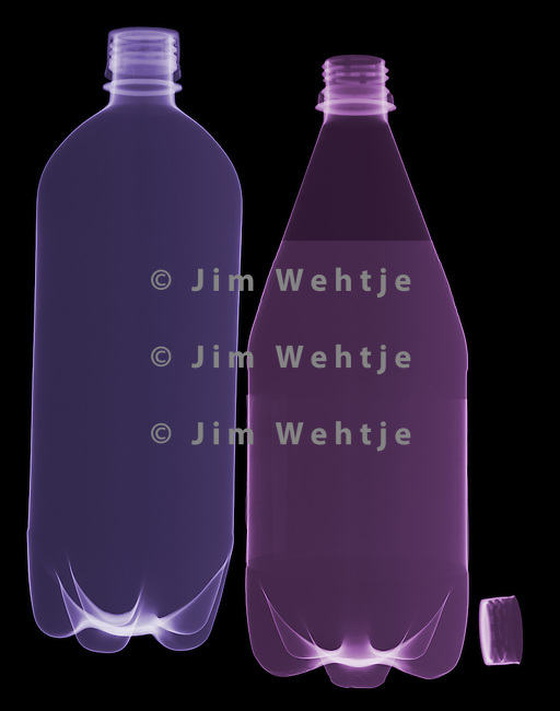 X-ray image of two water bottles (color on black) by Jim Wehtje, specialist in x-ray art and design images.