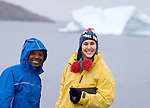 Chisomo and Luisa pose for a moment in front of an Iceberg. Cape Farewell Youth Expedition 08(©Robert vanWaarden ALL RIGHTS RESERVED)