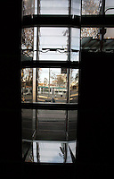 """Agbar Tower; Jean Nouvel (Fumel, Lot-et-Garonne, France 1945) and B720 architectural studio headed by Fermín Vázquez; June 1999 - Sept 2004; Window framed by mirrors seen from the inside; 142 meters height; 50,500 square meters built; 59,619 Glass Sheets; 4,349 Openings; 4500 Windows; 40 different colours; work included to the exhibition """"On-site, new architecture in Spain"""" at the Museum of Modern Art (New York, Feb - May 2006), Barcelona, Catalonia, Spain Picture by Manuel Cohen"""