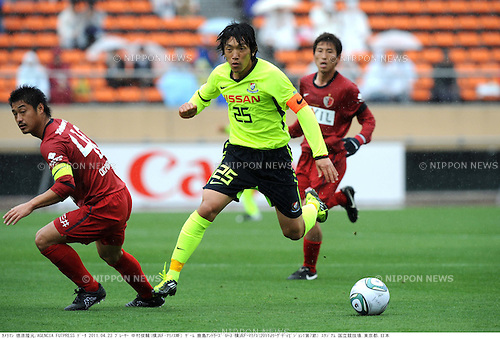 (R-L) Shunsuke Nakamura (Marinos), Mitsuo Ogasawara (Antlers), APRIL 25th, 2011 - Football : 2011 J.League Division 1 match between Kashima Antlers 0-3 Yokohama Marinos at National Stadium in Tokyo, Japan. The J.League resumed on Saturday 23rd April after a six week enforced break following the March 11th Tohoku Earthquake and Tsunami. All games kicked off in the daytime in order to save electricity and title favourites Kashima Antlers are still unable to use their home stadium which was damaged by the quake. Velgata Sendai, from Miyagi, which was hard hit by the tsunami came from behind for an emotional 2-1 victory away to Kawasaki. (Photo by Takamoto Tokuhara/AFLO).