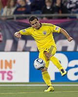 Columbus Crew midfielder Dilly Duka (11) clears the ball.  In a Major League Soccer (MLS) match, the Columbus Crew defeated the New England Revolution, 3-0, at Gillette Stadium on October 15, 2011.