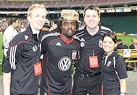 Staff of D.C. United pose with hip-hop star Wale during an MLS match against the New England Revolution on April 3 2010, at RFK Stadium in Washington D.C.