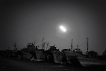 Damaged fishing boats recovered following the March 11 tsunami are lined up on the quayside in Yamada, Iwate Prefecture, Japan.  Photographer: Robert Gilhooly