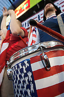 A USA Fan uses a drum to lead cheers while the United States Men's National Team played Guatemala at Livestrong Sporting Park in Kansas City, Kansas in a World Cup Qualifier on Tue. Oct. 16, 2012.