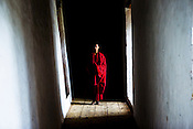 A Buddhist monk poses for a portrait on corridor inside the Punakha Dzong (fortress) in Punakha, Bhutan. Phunakha was the capital of Bhutan and the seat of government until 1955, when the capital was moved to Thimphu. Punakha is the administrative centre of Punakha dzongkhag, one of the 20 districts of Bhutan. Photo: Sanjit Das/Panos