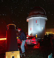 President of the Charlottesville Astronomical Society Tom Ayers looks through his personal telescope during public night at Fan Mountian in Covesville, Va. Photo/Andrew Shurtleff star view