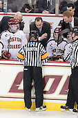 Jeff Bunyon explains the goal review to the BC coaching staff - Jim Logue (BC - Assistant Coach), Mike Cavanaugh (BC - Associate Head Coach), Greg Brown (BC - Associate Head Coach) as Danny Linell (BC - 10), Michael Sit (BC - 18) and Tom Maguire (BC - Senior Manager) look on. - The Boston College Eagles defeated the visiting University of New Hampshire Wildcats 5-2 on Friday, January 11, 2013, at Kelley Rink in Conte Forum in Chestnut Hill, Massachusetts.