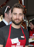 Los Angeles, CA - NOVEMBER 23: Dustin Milligan, At Los Angeles Mission Thanksgiving Meal For The Homeless At Los Angeles Mission, California on November 23, 2016. Credit: Faye Sadou/MediaPunch