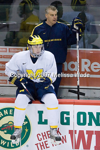 Chris Summers (Michigan 4) and Billy Powers (Michigan Assistant Coach) take part in the Wolverines' morning skate at the Xcel Energy Center in St. Paul, Minnesota, on Friday, October 12, 2007, during the Ice Breaker Invitational.