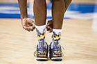 Mar. 28, 2015; Jerian Grant adjusts his socks during practice prior to the NCAA Tournament regional final at Quicken Loans Arena. (Photo by Matt Cashore/University of Notre Dame)