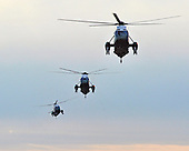 Marine 1 and two decoys approach the South Lawn of the White House in Washington, D.C. following United States President Barack Obama's quick trip to Cleveland, Ohio to discuss the economy..Credit: Ron Sachs / Pool via CNP