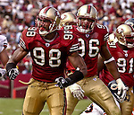 San Francisco 49ers linebacker Julian Peterson (98) and defensive end Andre Carter (96) are pumped up after sack on Sunday, September 7, 2003, in San Francisco, California. The 49ers defeated the Bears 47-7.