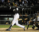 CHICAGO - APRIL 12:  Alexei Ramirez #10 of the Chicago White Sox hits a walk-off game winning home run off of Bobby Cramer #26 of the Oakland Athletics in the 10th inning on April 12, 2011 at U.S. Cellular Field in Chicago, Illinois.  Ramirez hit two home runs on the night. The White Sox defeated the Athletics 6-5.  (Photo by Ron Vesely)  Subject:  Alexei Ramirez;Bobby Cramer.