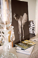 On the grey marble mantelpiece in the living room a black-and-white family photograph takes pride of place next to an ornate crystal candlestick