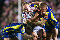 Picture by Alex Whitehead/SWpix.com - 16/03/2017 - Rugby League - Betfred Super League - Leigh Centurions v Warrington Wolves - Leigh Sports Village, Leigh, England - Leigh's Jamie Acton is tackled by Warrington's Daryl Clark, Joe Westerman and Mike Cooper.